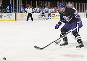 Andrew Gladiuk (Bentley - 12), Logan Smith (HC - 33) - The Bentley University Falcons defeated the College of the Holy Cross Crusaders 3-2 on Saturday, December 28, 2013, at Fenway Park in Boston, Massachusetts.
