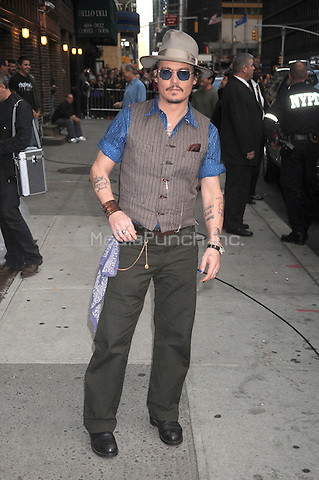 Johnny Depp at the Ed Sullivan Theater for an appearance on Late Show with David Letterman in New York City. October 26, 2011. © mpi01 / MediaPunch Inc.