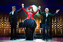London, UK. 21.03.2014. I CAN'T SING, by Harry Hill and Steve Brown, directed by Sean Foley, opens at the London Palladium. Picture shows: Nigel Harman (as Simon Cowell), Victoria Elliott (as Jordy) and Ashley Wright (as Louis). Photograph © Jane Hobson.