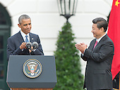 United States President Barack Obama completes his remarks welcoming President XI Jinping of China during an official State arrival ceremony on the South Lawn of the White House in Washington, DC on Friday, September 25, 2015.<br /> Credit: Ron Sachs / CNP