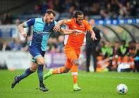 Blackpool's Nathan Delfouneso under pressure from Wycombe Wanderers' Max Muller<br /> <br /> Photographer Kevin Barnes/CameraSport<br /> <br /> The EFL Sky Bet League Two - Wycombe Wanderers v Blackpool - Saturday 11th March 2017 - Adams Park - Wycombe<br /> <br /> World Copyright &copy; 2017 CameraSport. All rights reserved. 43 Linden Ave. Countesthorpe. Leicester. England. LE8 5PG - Tel: +44 (0) 116 277 4147 - admin@camerasport.com - www.camerasport.com
