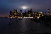 New  York, New York.September 11, 2011..Two lights rise to the sky from lower Manhattan representing the Twin Towers which stood there 10 years ago to the day. The image was made from Brooklyn.