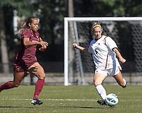 Boston College midfielder Lauren Bernard (5) dribbles as Virginia Tech forward Jazmine Reeves (5) closes.Virginia Tech (maroon) defeated Boston College (white), 1-0, at Newton Soccer Field, on September 22, 2013.