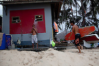 Jibe's employees shower off after making the most out of the off season for high winds.  The kite surfing season usually runs from November until March.