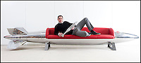 BNPS.co.uk (01202 558833)<br /> Pic: PhilYeomans/BNPS<br /> <br /> Bespoke furniture for the Jet Set.<br /> <br /> Brett Armstrong on a &pound;20,000 couch made from a USAF Corsair droptank.<br /> <br /> Two brother's have come up with ultimate in aircraft recycling - turning unwanted bits of redundant airliners into highly desirable - and highly expensive - bespoke items of furniture.<br /> <br /> Brett and Shane Armstrong from Kent scour the worlds aircraft graveyards looking for interesting items they can rescue from sad decay and with a lot of imagination and elbow grease convert into one-off gleaming items of furniture costing thousands of pounds.
