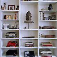 The apartment is accessorised with a variety of Asian pieces collected by the owners on their travels