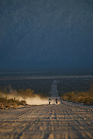 Two offroad motorcyle riders travel down sandy desert road in Baja California, Mexico