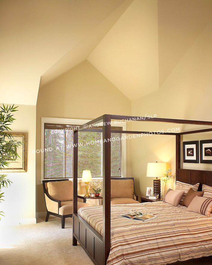 Master Bedroom With A Sloped, Angled Ceiling