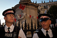 The Statue on strike - 2011<br /> <br /> London, 15/10/2011. St Paul's Square became the stage of the UK arm of the &quot;Occupy&quot; protest movement which has been growing around the world. The Occupy movement is a world-wide protest against the financial crises created by the actual financial system, by speculation, by deregulation, and by the actions of major international financial and investment banks. Around 2,000 protesters armed with tents and placards, gathered outside the famous Cathedral intending to occupy Paternoster Square, home of the London Stock Exchange and the heart of the City of London, but they were hampered by City police officers. After this failed attempt the protesters decided to camp in front St Paul's where the situation with police forces became immediately tense. Masked like the character of Guy Fawkes from the movie &quot;V for Vendetta&quot;, Julian Assange appeared on the square to give a speech in support of the protesters. During the late evening police forces heavily armed with riot control equipment charged the square, attempting to evict the occupants who resisted. Later in the evening the police retreated and the occupation continued peacefully.