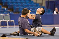 The arm pull at the 2008 World Eskimo Indian Olympics held annually in Fairbanks, Alaska. Brute strength is revered when bringing the quarry out of the hole in the ice.