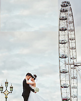 A Chinese couple pose for their wedding photos in London close to the London Eye, London, UK.  An increasing number of Chinese couple are having their wedding photos taken in the English country-side, classic towns and monuments to show in China.