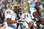 15 November 2014: Pitt's James Conner (24) celebrates his touchdown with Devon Edwards (45) and Jaryd Jones-Smith (75). The University of North Carolina Tar Heels hosted the University of Pittsburgh Panthers at Kenan Memorial Stadium in Chapel Hill, North Carolina in a 2014 NCAA Division I College Football game. UNC won the game 40-35.