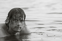 good looking man with long hair relaxing in the bay in Amagansett, NY