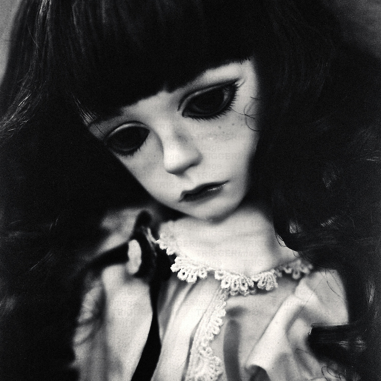 portrait of a sad colette the doll