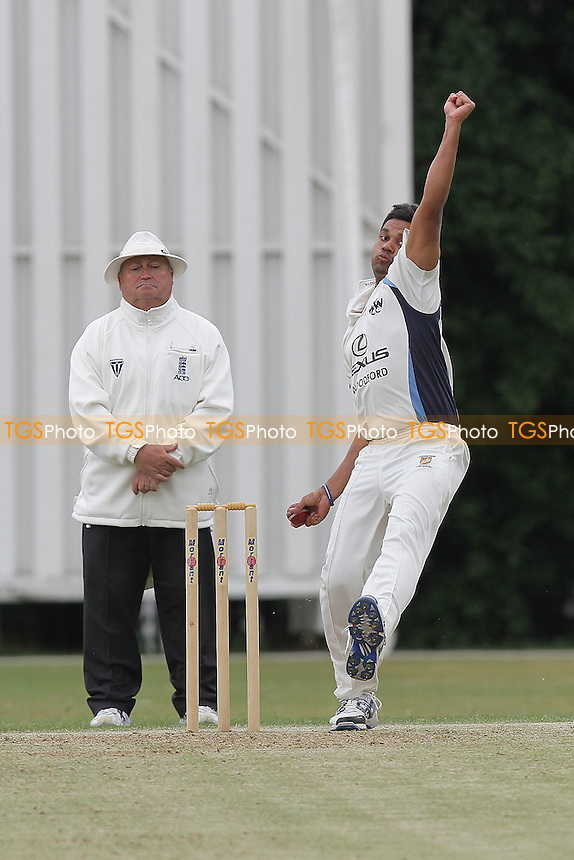 M Chowdhury in bowling action for Woodford Wells - Woodford Wells CC (fielding) vs Ilford CC - Essex Cricket League - 28/05/11 - MANDATORY CREDIT: Gavin Ellis/TGSPHOTO - Self billing applies where appropriate - Tel: 0845 094 6026