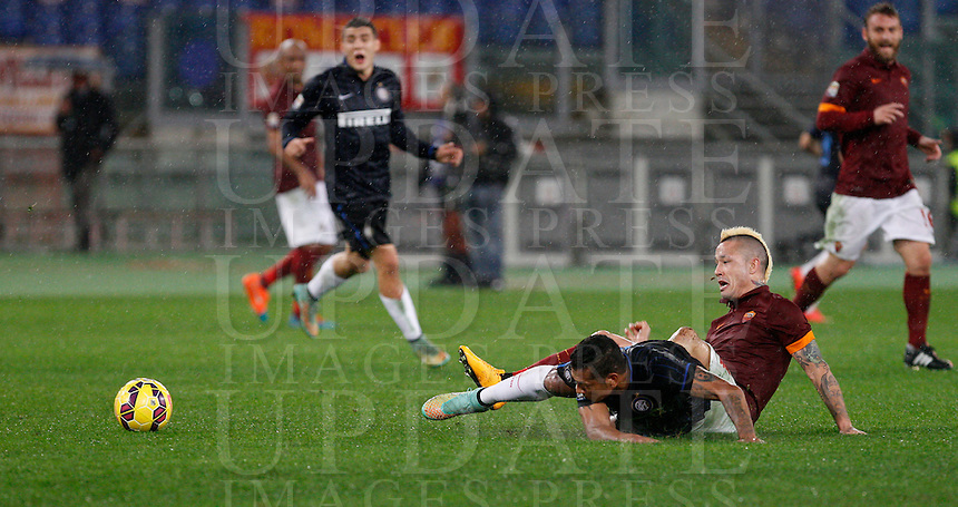 Calcio, Serie A: Roma vs Inter. Roma, stadio Olimpico, 30 novembre 2014.<br /> FC Inter&rsquo;s Fredy Guarin and Roma&rsquo;s Radja Nainggolan, right, fight for the ball during the Italian Serie A football match between AS Roma and FC Inter at Rome's Olympic stadium, 30 November 2014.<br /> UPDATE IMAGES PRESS/Riccardo De Luca