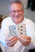 """Tom Whiteside, owner of Durham Cinematheque, holds both the last and the first card he found for his installation; """"Cards: Two Decks"""" on Thursday June 28th 2012."""