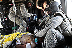 Flight medic Staff Sgt. Rakheem Francis, 24, of Queens, N.Y., (right) and crew chief Sgt. 1st Class Lloyd Swaby, 36, of Fort Lauderdale, Fla. (left), with the 101st Combat Aviation Brigade's &quot;Shadow Dustoff,&quot; treat an Afghan soldier who was severely wounded in a Taliban ambush near Kandahar, Afghanistan. The soldier died a short time later. Sept. 19, 2010. DREW BROWN/STARS AND STRIPES