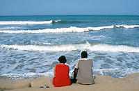 Gambia. Kombo beach. Atlantic ocean. Kombo beach is 25 km away from the capital Banjul. Sex tourism. A white woman and her black lover look at the sea and enjoy the beauty of the waves and the landscape.  © 2000 Didier Ruef
