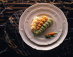 Top Shot of Pea Carrott &amp; Potato vegetable puree on a white plate on black marble