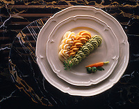 Top Shot of Pea Carrott & Potato vegetable puree on a white plate on black marble