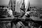 barwaiz raghzai hills, south waziristan, april 2004: a member of the tribal lashkar called by the ahmedzai tribe<br />