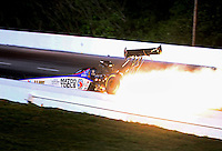 May 16, 2014; Commerce, GA, USA; NHRA top fuel dragster driver Antron Brown loses his rear wing in an explosion prior to crashing during qualifying for the Southern Nationals at Atlanta Dragway. Brown was uninjured in the 318 mph crash. Mandatory Credit: Mark J. Rebilas-USA TODAY Sports