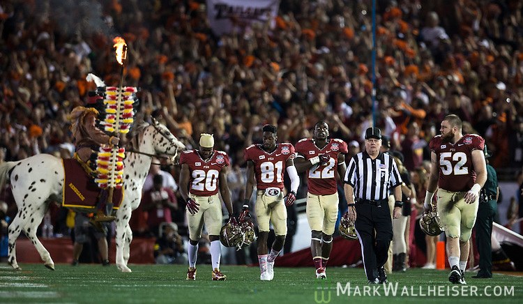 Game captains Lamarcus Joyner (20), Kenny Shaw (81), Telvin Smith (22) and Bryan Stork take the field for the coin toss prior to the BCS national title game at the Rose Bowl in Pasadena, California on January 6, 2014.   The Florida State Seminoles defeated the Auburn Tiger 34-31 to win the final BCS National Championship.