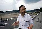 Dr. Sen Hiraizumi stands atop of the roof where he evacuated his 49 mostly elderly patients at the Yamada  town Prefectural Hospital in Yamada town, Iwate Prefecture, Japan on  10 June 20011.  .Photographer: Robert Gilhooly