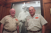 Don Tyson with photo of Don's father John W. Tyson and some Don H. Tyson at the Tyson Foods corporate headquarters in Springdale. Arkansas Dated 9/13/1999.