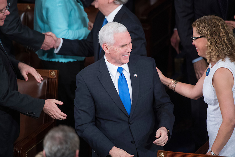 UNITED STATES - FEBRUARY 28: Vice President Mike Pence and Rep. Debbie Wasserman Schultz, D-Fla., are seen in the House Chamber before President Donald Trump addressed a joint session of Congress in the Capitol, February 28, 2017. (Photo By Tom Williams/CQ Roll Call)