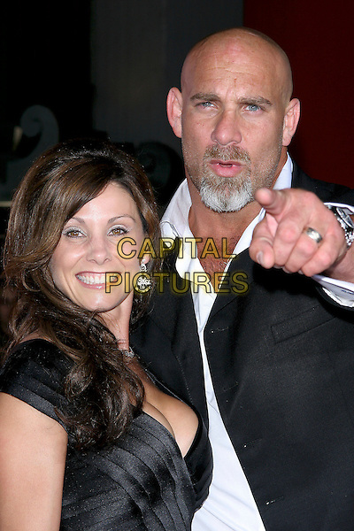 """BILL GOLDBERG & WIFE.World Premiere of """"The Longest Yard"""" held at Grauman's Chinese Theatre..May 19th, 2005.Photo Credit: Jacqui Wong/AdMedia.headshot portrait pointing gesture goatee facial hair.www.capitalpictures.com.sales@capitalpictures.com.© Capital Pictures."""