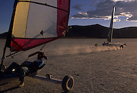 Land yachts race across the Alvord playa's flat landscape beneath the mile high fault-block of Steen's Mountain. Fans of the sport flock to the ancient lake bed in search of speeds beyond most posted interstate highway limits; the world record stands above 116 miles per hour. Determination counts for those who travel hours to this isolated corner of southeastern Oregon and contend with extreme heat in summer, the only season when playa is reliably dry enough for sailing.