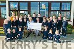 Ballincrossig School BALLYDUFF  raised € 215 for Trocaire through various events. Pictured principal Dianne Crean and pupils and staff  presented the cheque to Jim Cremin of Trocaire on Monday
