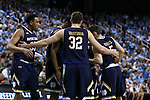 05 February 2017: Notre Dame players huddle during a stoppage in play. The University of North Carolina Tar Heels hosted the University of Notre Dame Fighting Irish at the Greensboro Coliseum in Greensboro, North Carolina in a 2016-17 Division I Men's Basketball game. The game had been postponed one day and moved from Chapel Hill due to a water shortage. UNC won the game 83-76.