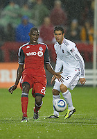 Chicago Fire forward Orr Barouch #15 and Toronto FC midfielder Tony Tchani #22 in action during an MLS game between the Chicago Fire and the Toronto FC at BMO Field in Toronto on May 14, 2011..The game ended in a 2-2 draw.