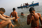 After a training session, the wrestlers take a dip in the holy Ganges river to wash off the dirt and pay tribute to the gods. The sport and its religious observance are deeply woven. Each akhara has its own shrine for the warrior god Hanuman. The ancient tradition of Indian wrestling, known as  kushti, thrives in Varanasi, one of the world's oldest cities. Wrestling gyms, or akhara, scattered around the city are of the few places where Hindu men from different casts are considered equals. Aside from bodybuilding, practiioners emphasize a life of discipline and celibacy. But as modernity sweeps India and Western sports like cricket become more popular, some akhara are being abandoned. While some prominent, government-run gyms switched to mats for Olympic-style wrestling, akhara in villages and towns maintain the old ways.