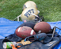 23 September 2006: Pitt Panthers football gear including helmets, shoes, footballs, kicking tee, Gatorade, kicking net and tape.