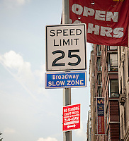 """A sign on Broadway in New York  proclaims the new """"Broadway Slow Zone"""" on Monday, August 4, 2014. As part of Mayor Bill de Blasio's """"Vision Zero"""" initiative the speed limit of 30 mph has been reduced to 25 mph. Broadway from West 59th Street to West 220 Street has been posted as a """"Slow Zone"""". with the other """"Slow Zone"""" starting today atSouthern Blvd. in the Bronx. Two dozen zones will be instituted in the five boroughs over the course of several months. 22 pedestrians have been killed since 2008 in the """"Broadway Slow Zone"""" and speeding is the top cause of traffic injuries and fatalities.   (© Richard B. Levine)"""