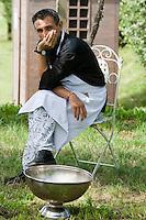 Portrait of a member of staff from the Ristorante Arquade near Verona taking a break in the garden