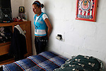 Rosario Hernandez Guereca, reacts in the room of her brother Sergio Adrian Hernandez Guereca, who was killed yesterday by a Border Patrol agent, on June 8, 2010 in Ciudad Juarez.