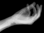 X-ray image of a cupped hand (white on black) by Jim Wehtje, specialist in x-ray art and design images.