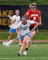 Megan Bosica (2) of North Carolina tries to control the ball in front of Laura Merrifield (9) of Maryland during the ACC women's lacrosse tournament finals in College Park, MD.  Maryland defeated North Carolina, 10-5.