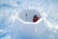 Saltoluokta Mountain Station, Jokkmokk, Lapland, Sweden, March 2013. Cecilia Lundin of Natulife Lapland, an experienced Igloo builder, takes us out for a igloo building workshop. Once you find the right compacted snow, the igloo building can start. Photo by Frits Meyst/Adventure4ever.com