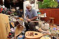 Artisan at work making musical instruments by hand in Bursa, Turkey. Picture by Manuel Cohen