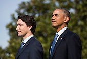 U.S. President Barack Obama (R) welcomes Prime Minister of Canada Justin Trudeau (L) at an arrival ceremony on the South Lawn of the White House, in Washington, DC, USA, 10 March 2016. This is the first official visit of Prime Minister of Canada Justin Trudeau to the White House. <br /> Credit: Jim LoScalzo / Pool via CNP