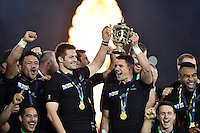Richie McCaw and Dan Carter of New Zealand lift the Webb Ellis Cup in celebration as their team are crowned World Champions. Rugby World Cup Final between New Zealand and Australia on October 31, 2015 at Twickenham Stadium in London, England. Photo by: Patrick Khachfe / Onside Images