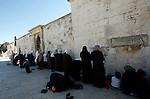Palestinian women attend the Friday prayers at the al-Aqsa mosque compound in Jerusalem's old city on November 30, 2012. Photo by Mahfouz Abu Turk