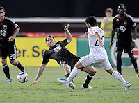 D.C. United defender Dejan Jakovic (5) goes down to defend the play against Vancouver Whitecaps FC Davide Chiumiento (20). D.C. United defeated The Vancouver Whitecaps FC 4-0 at RFK Stadium, Saturday August 13 , 2011.