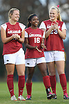 22 November 2013: Arkansas' Jeriann Okoro (16) between Yvonne DesJarlais (left) and Ashleigh Ellenwood (23). The University of Arkansas Razorbacks played the Saint John's University Red Storm at Koskinen Stadium in Durham, NC in a 2013 NCAA Division I Women's Soccer Tournament Second Round match. Arkansas won the game 1-0.